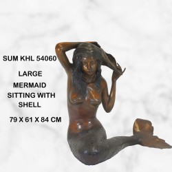 Mermaid holding shell water feature