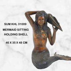 Mermaid with a shell water feature