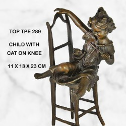 Child on chair statue