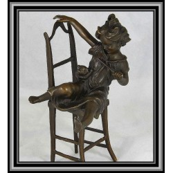 Child on Chair with Cat Statue Figurine Bronze