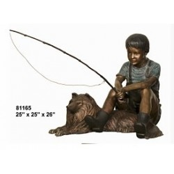 BOY FISHING WITH DOG STATUE