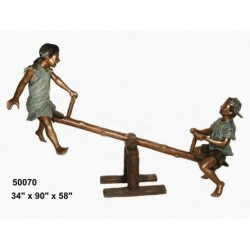 CHILDREN PLAYING ON SEE SAW BRONZE STATUE