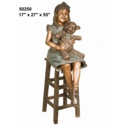 GIRL SITTING ON STOOL WITH TEDDY STATUE