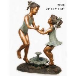 TWO LITTLE GIRLS DANCING AROUND FOUNTAIN